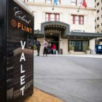 colcord hotel and flint valet sign in from of building