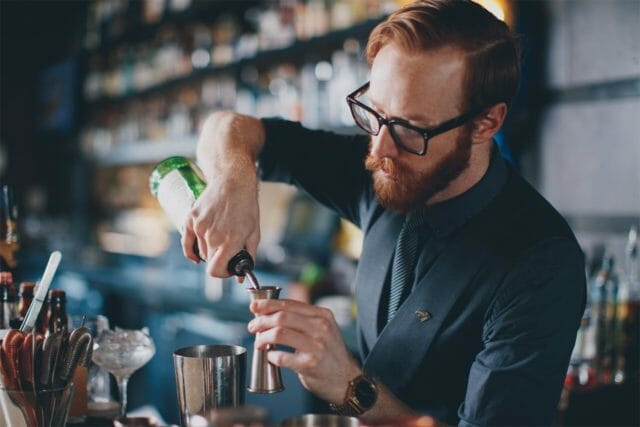 bartender working on mixing a cocktail