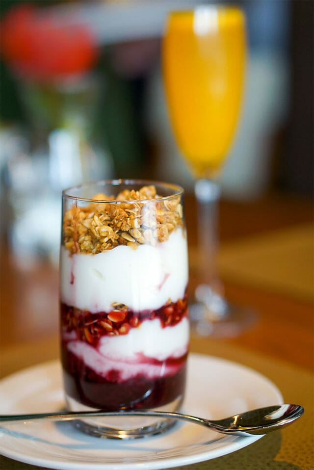 brunch parfait in tall glass and spoon