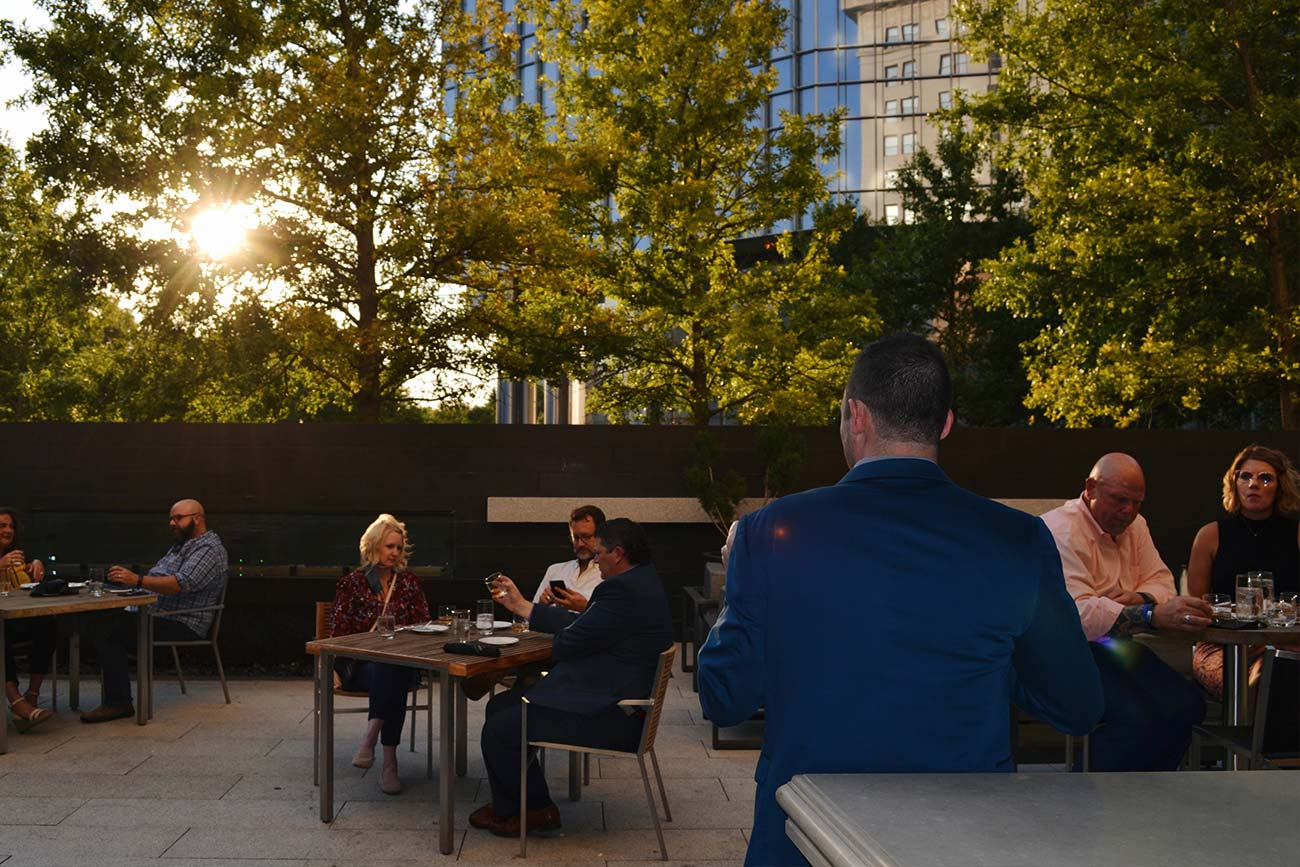 dining guests out on patio during evening