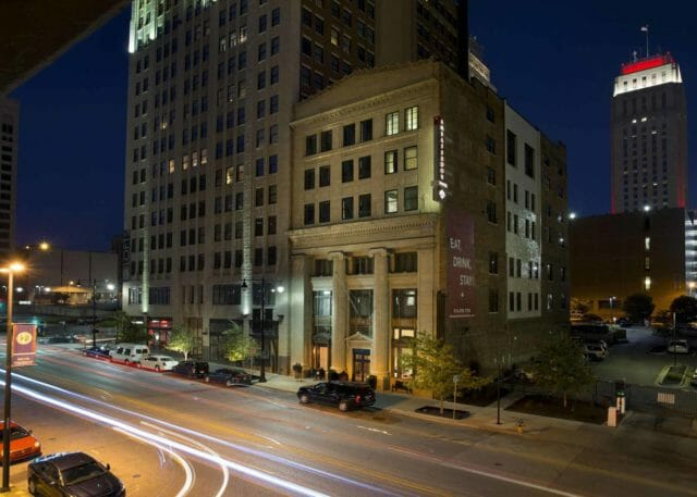 Exterior view at night of Ambassador Hotel Kansas City