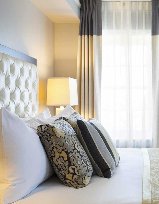 Pillows on a bed in a guest room at Amassador Hotel Tulsa
