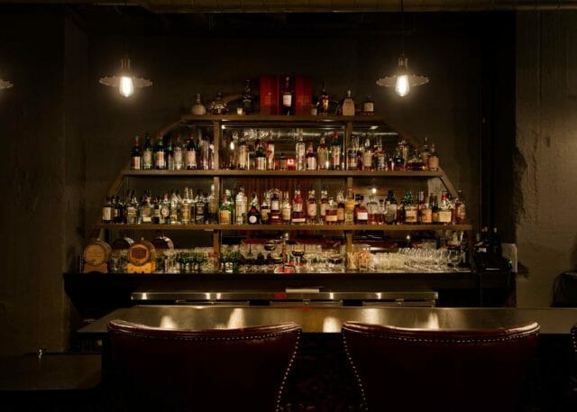 Bar seating and bottles at Dockum speakeasy bar in Wichita