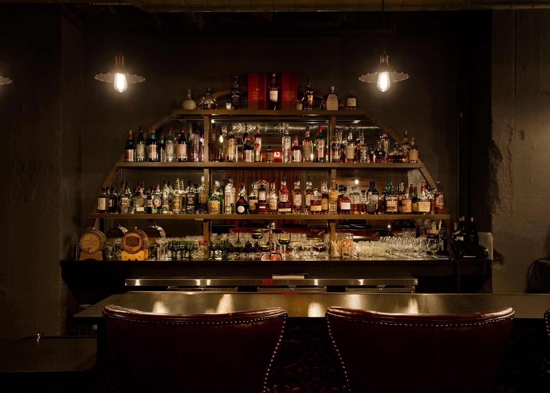 Bar seating and bottles at Dockum speakeasy bar in Wichita