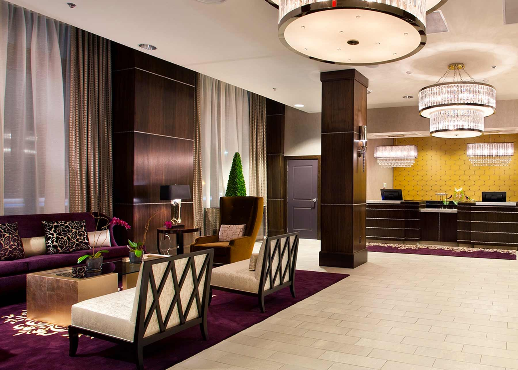 a bold and lavish lobby with seating under a bright light