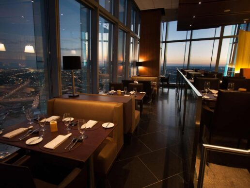 Interior view of dining room and Oklahoma City skyline at Vast restaurant