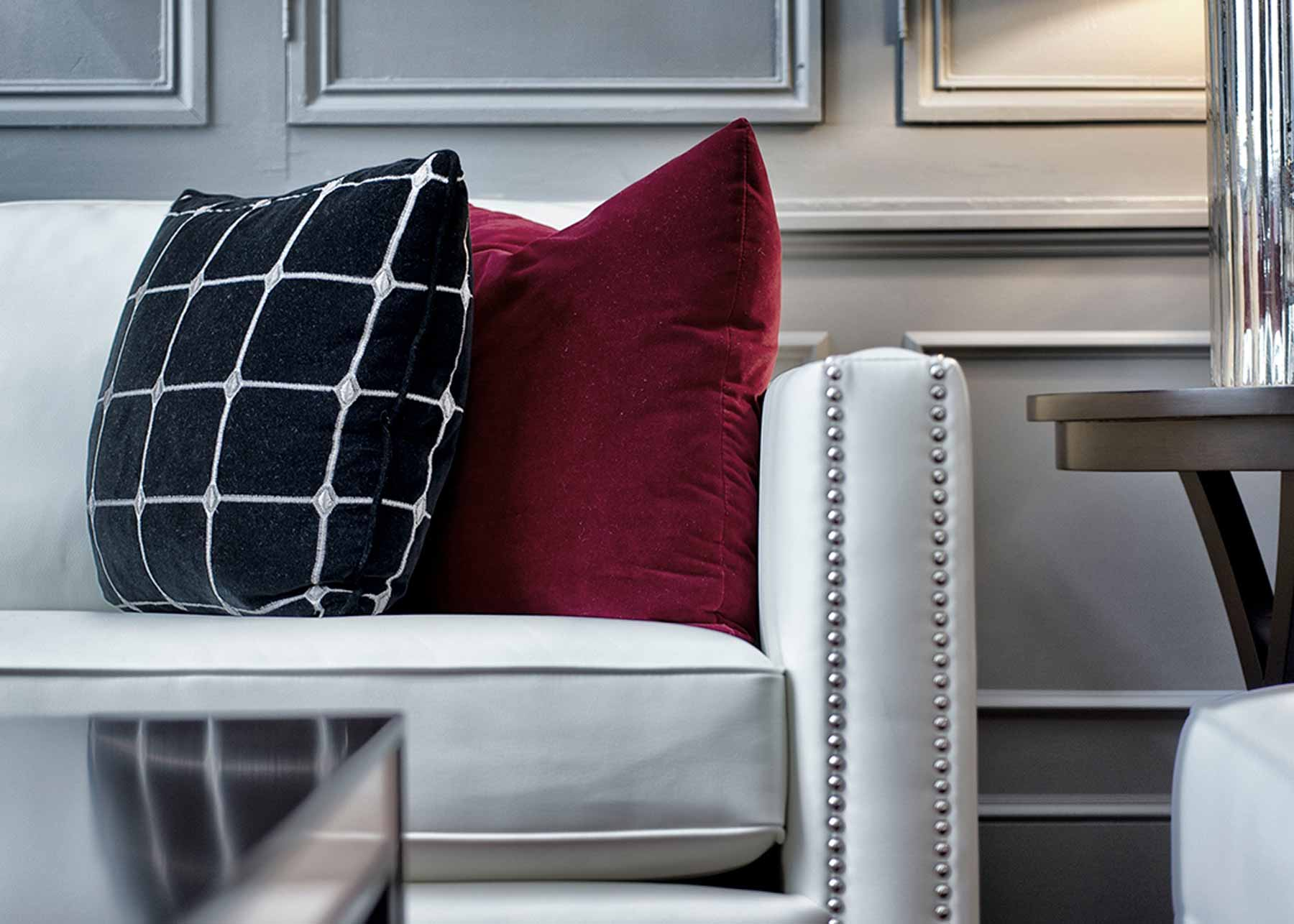 close up shot of a couch and two decorative pillows