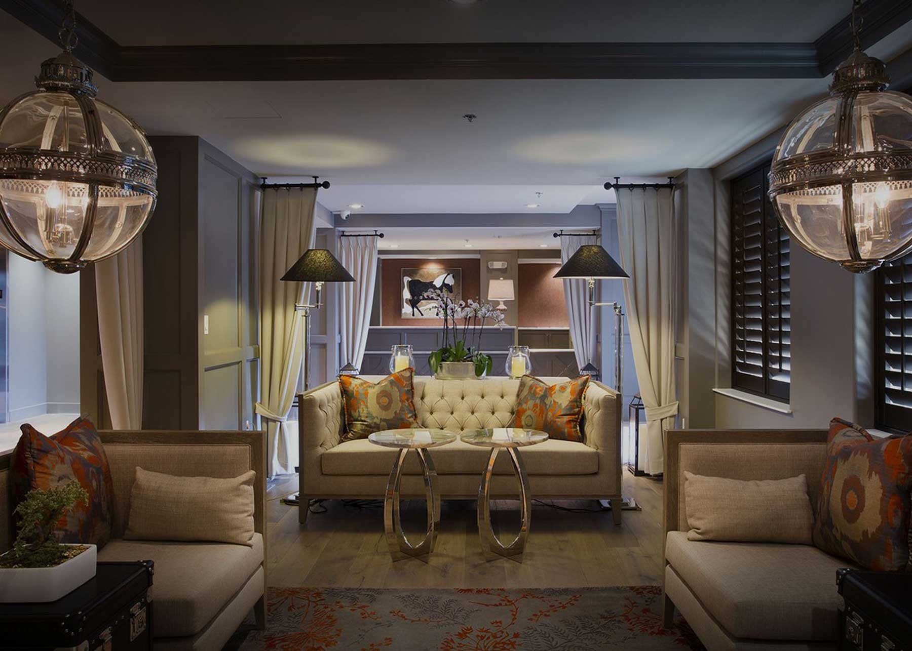 lavish suite sitting area with dim lights and a centre couch