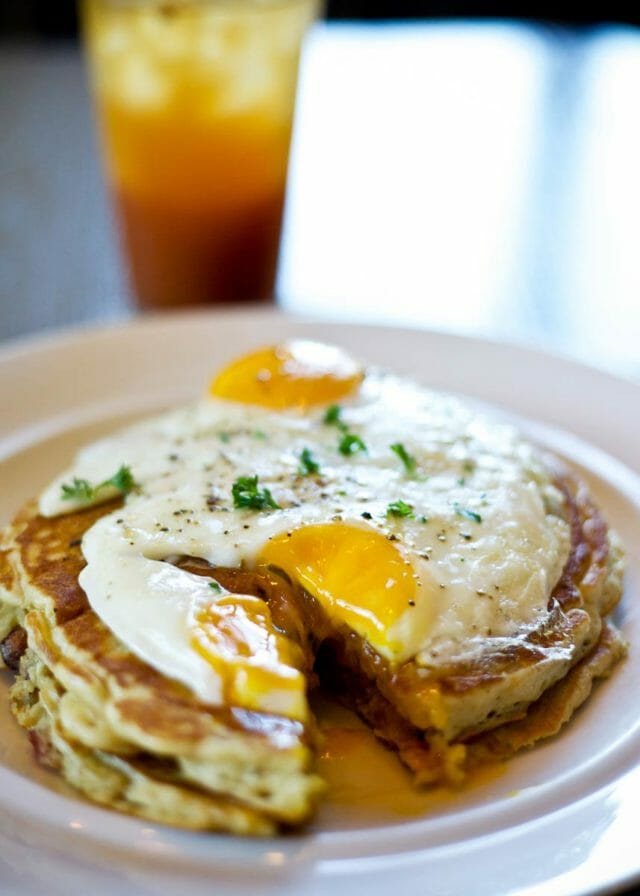 Pancakes with egg on a plat at Café Cuvée, Oklahoma City