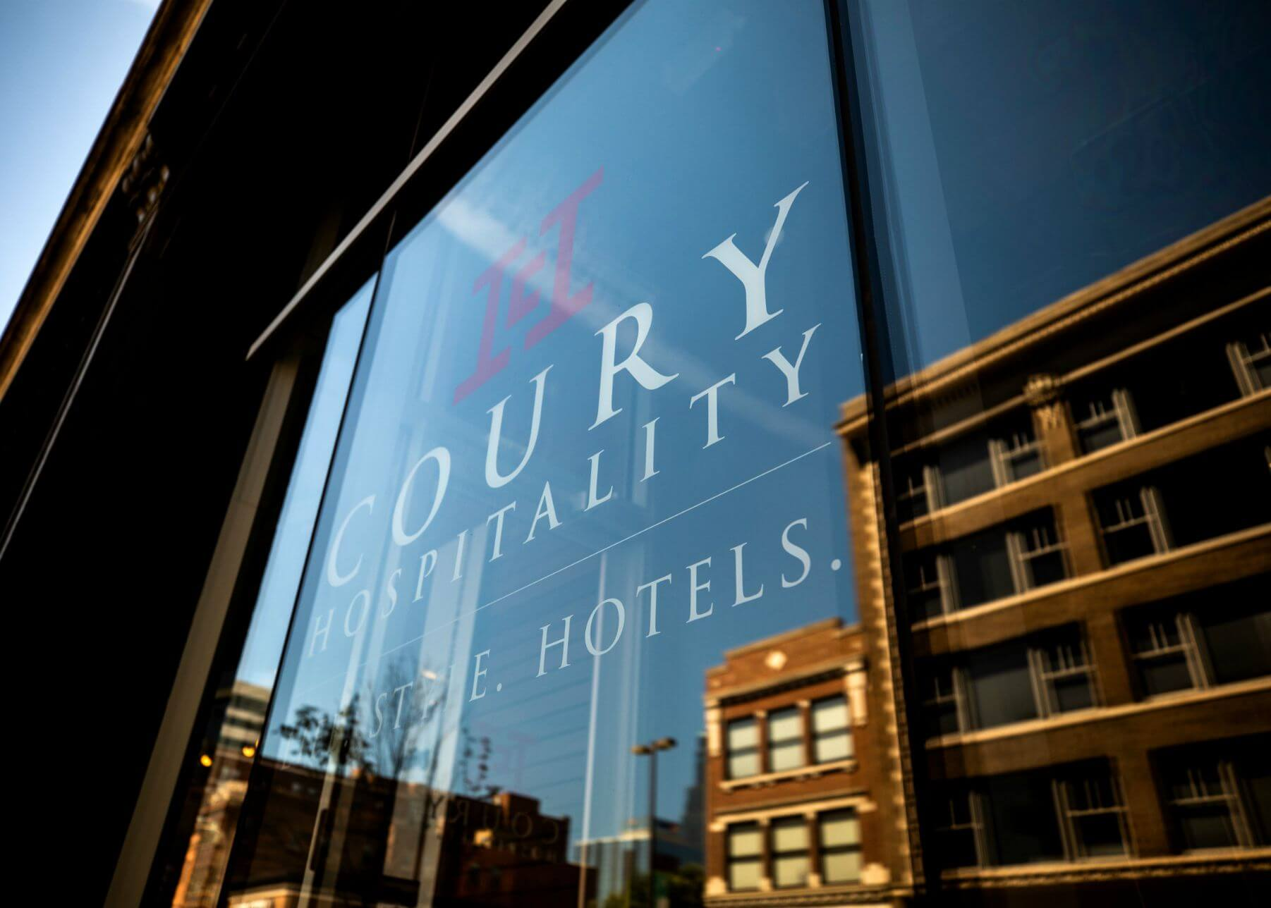 Coury Hospitality signage on office window in downtown Kansas City
