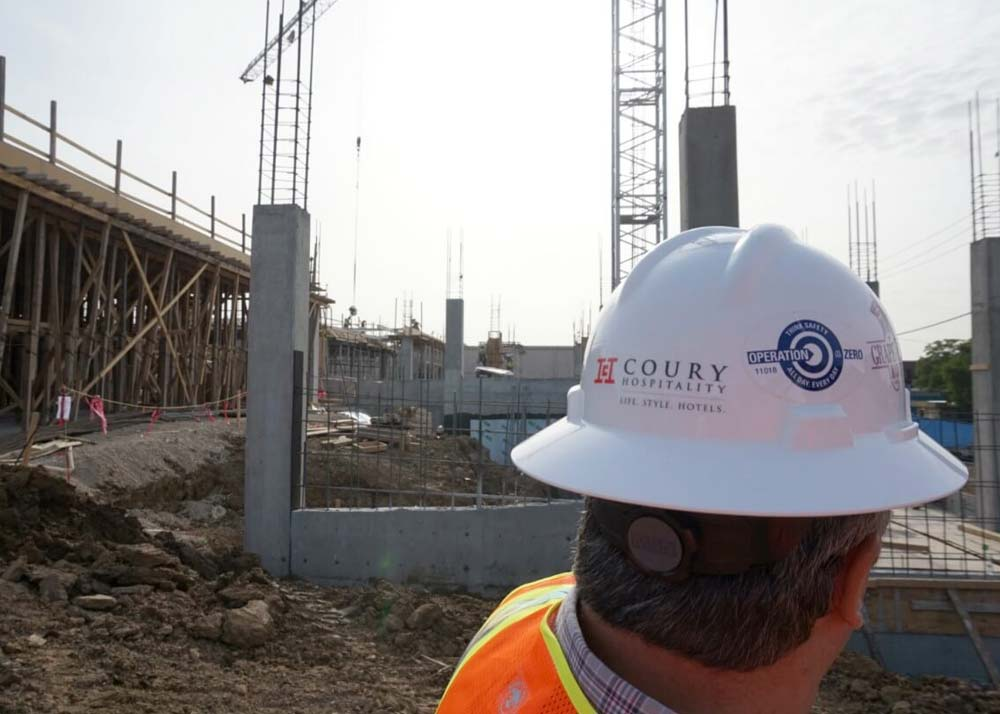 A man inspects a construction site in Grapevine, Texas