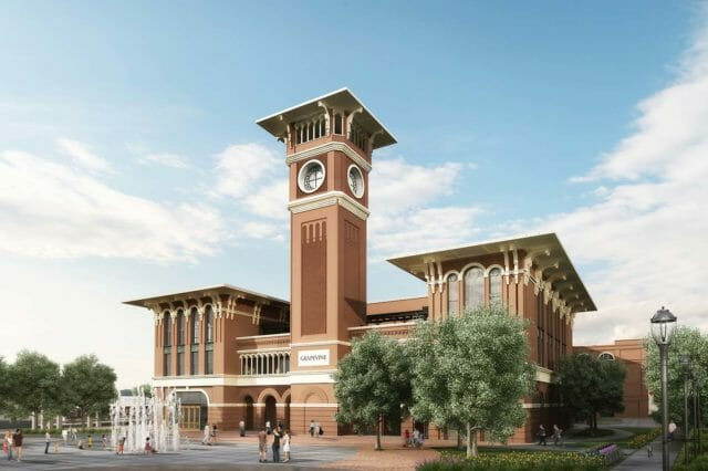 A daytime rendering of a large brick building surrounded by trees with a clock tower in the center, and a water fountain in front