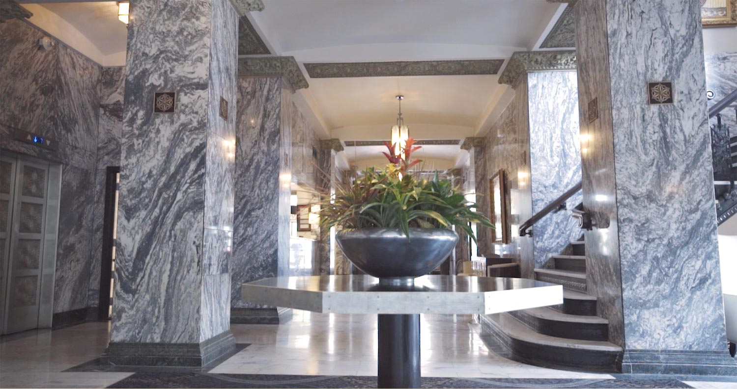 hotel lobby with grey marble columns and walls