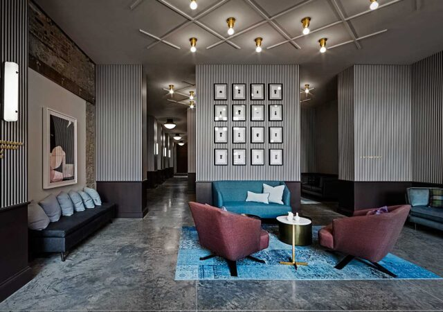large hotel lobby with artwork wall