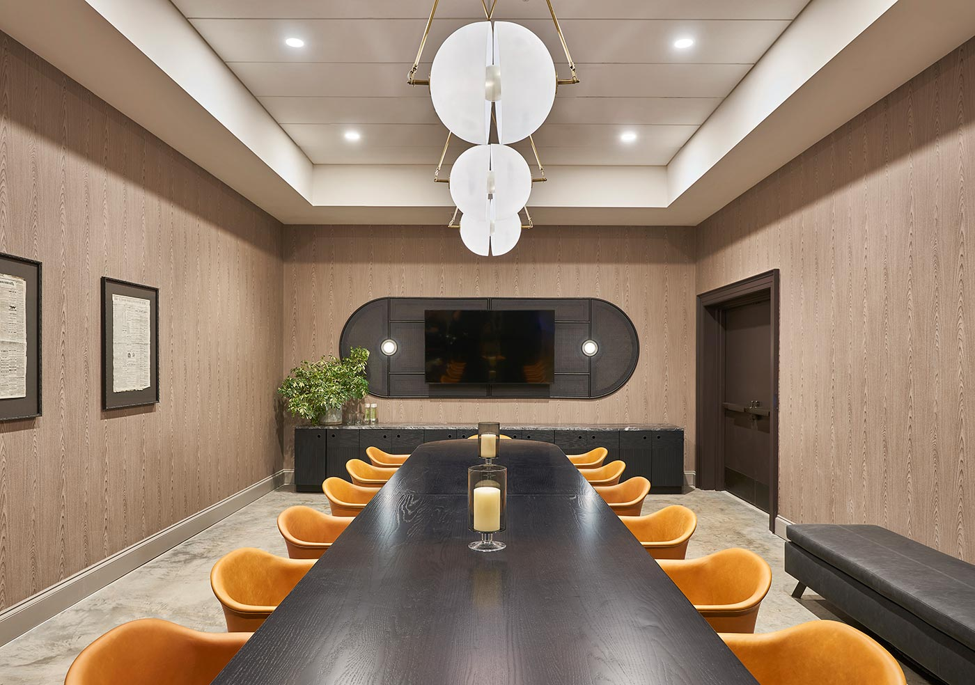 long meeting table with chairs and ceiling lights