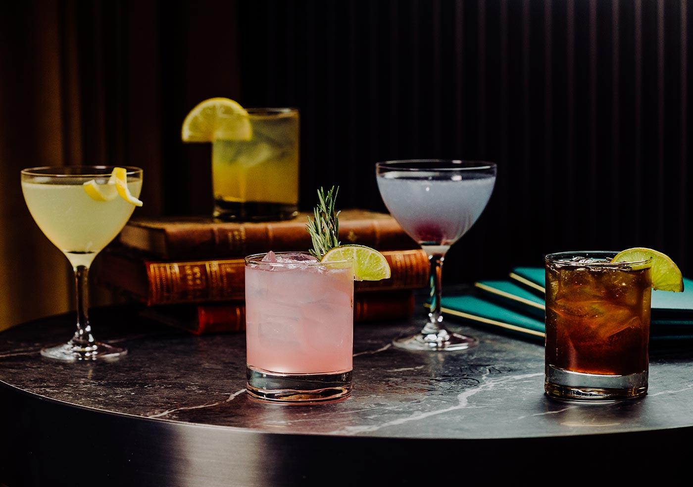 five different multicoloured cocktail glasses
