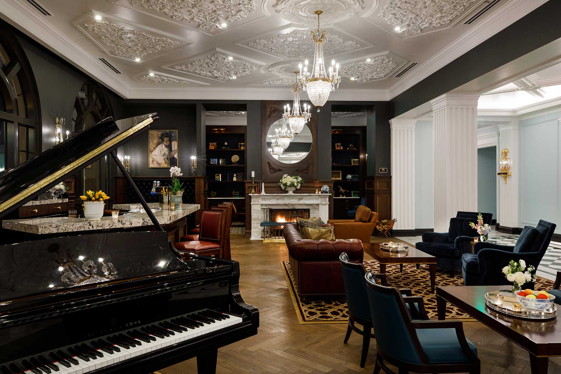 luxury hotel lounge with seating area and grand piano