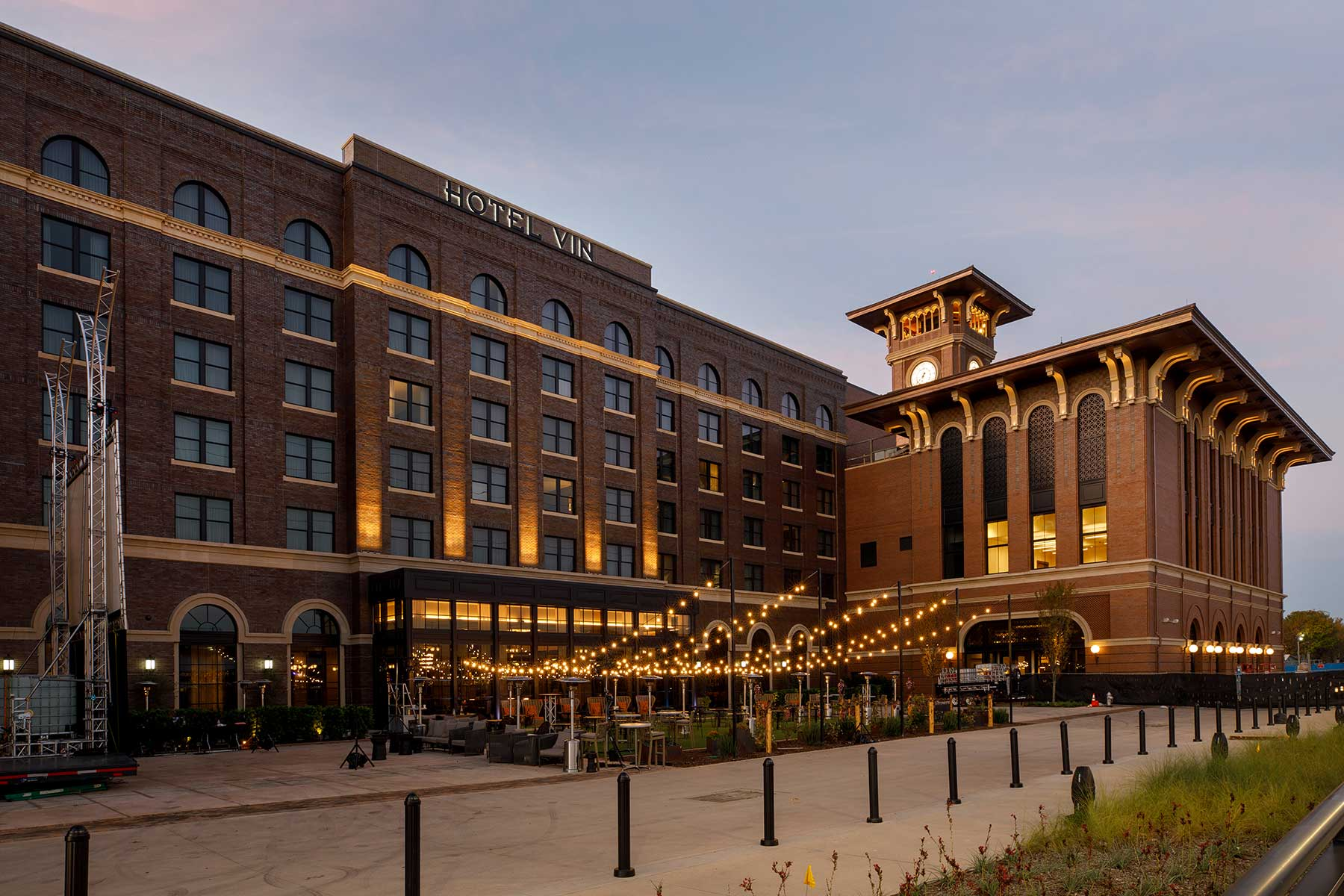 hotel vin building and patio exterior at dusk