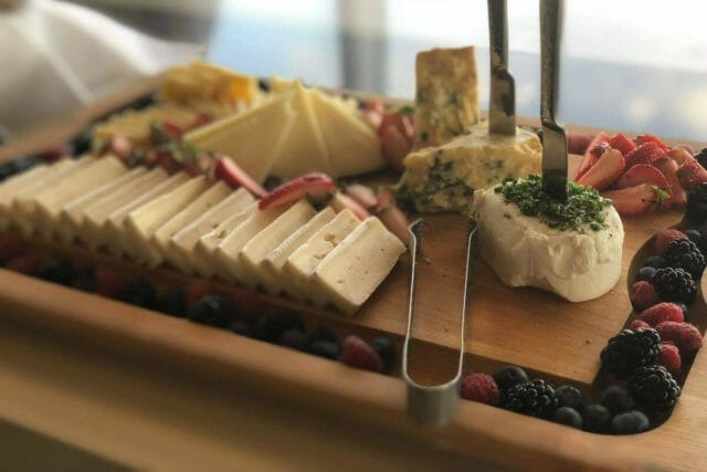 a cheese board with berries