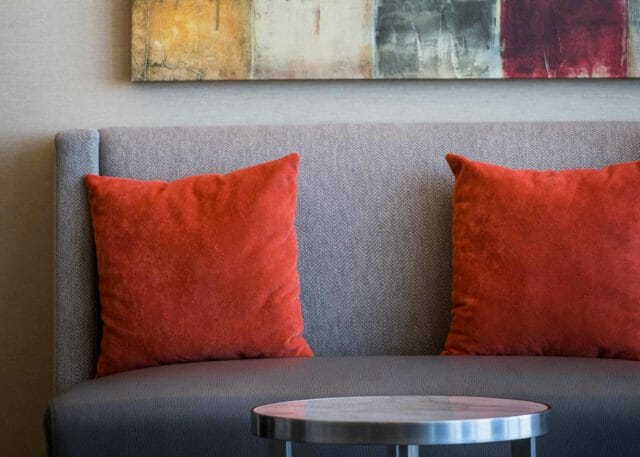 close up of pillows on comfortable sofas within the event space
