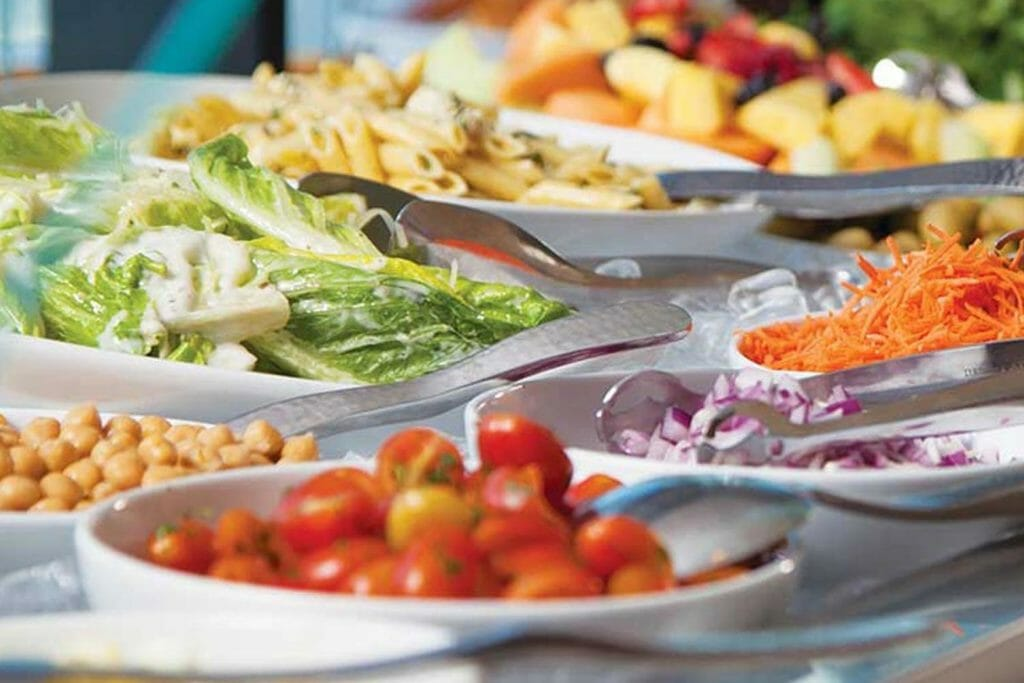 daily table buffet of fresh lettuce, tomatoes, salad toppings, onions, and more