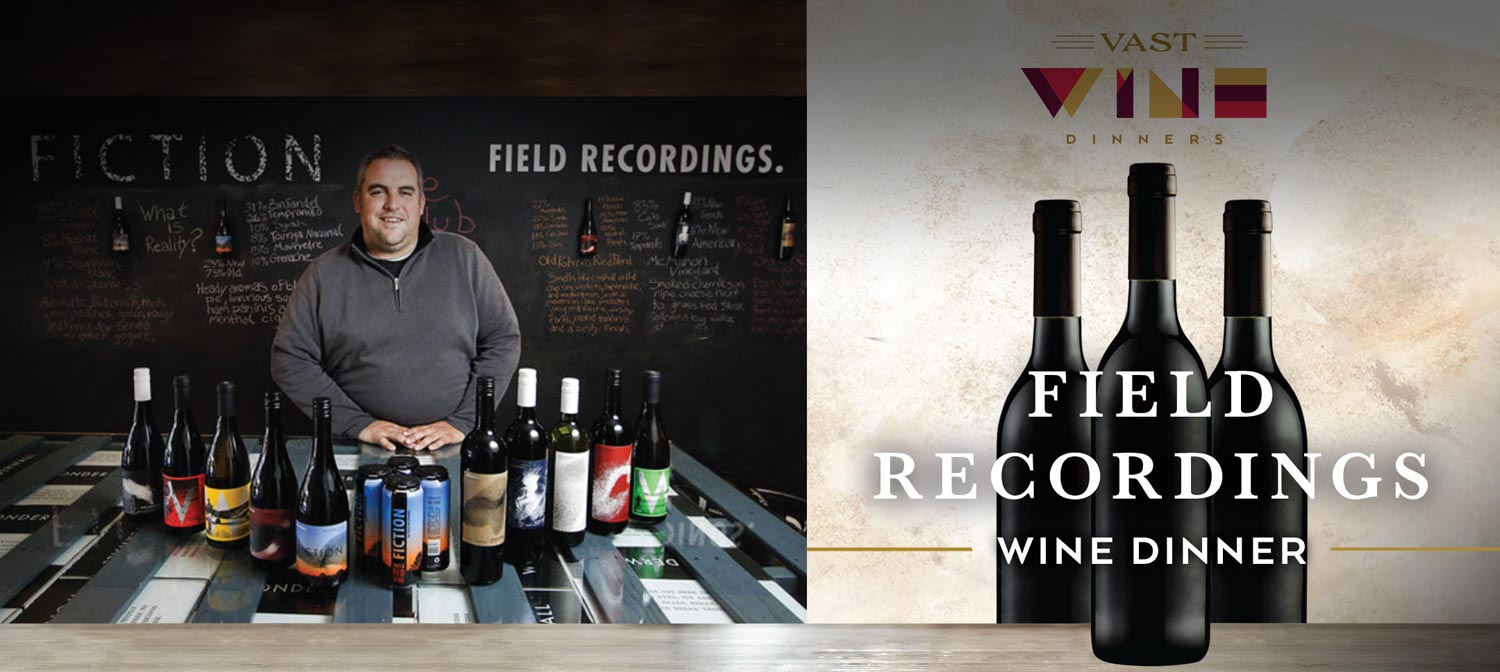 Field Recordings' man standing in front of an array of wine bottles
